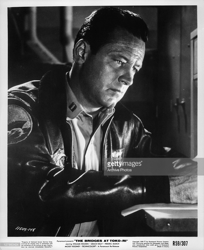 Lt Harry Brubaker (William Holden) writing in a scene from the film The Bridges at Toko-ri (Paramount Pictures photo)